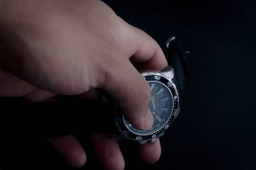Close-Up Photo Of Person Holding A Wristwatch
