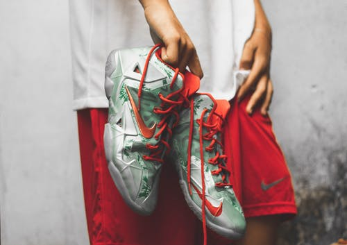 Photo Of Person Holding Basketball Shoes