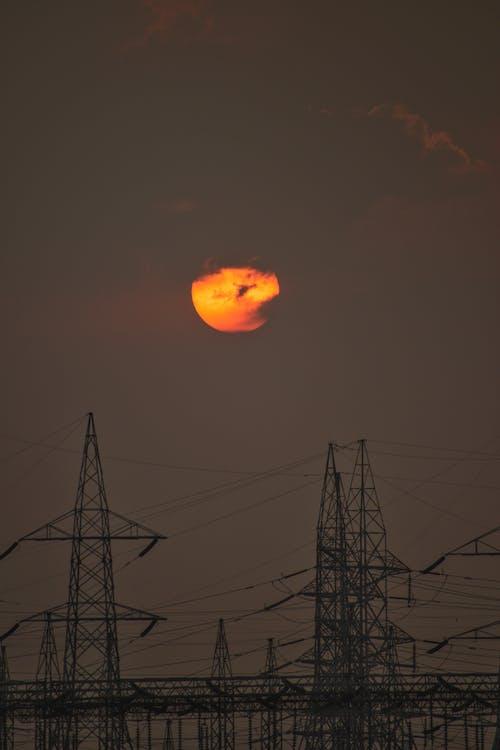 Fotos de stock gratuitas de amanecer - amanecer, amanecer urbano, poste de electricidad, sol