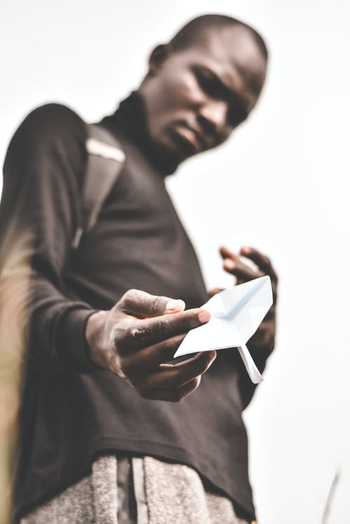 Selective Focus Photo Of Person Holding Paper Plane