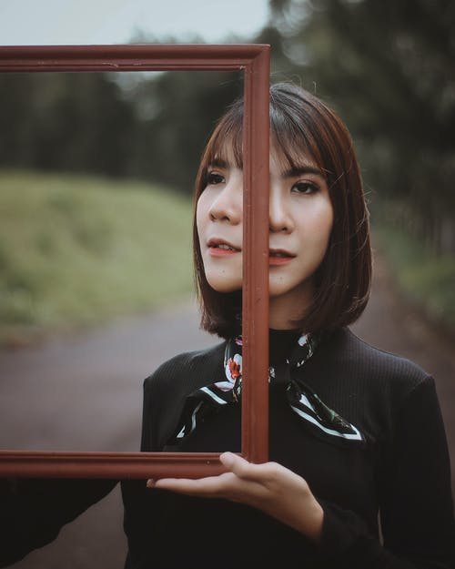 Photo Of Woman Holding Mirror