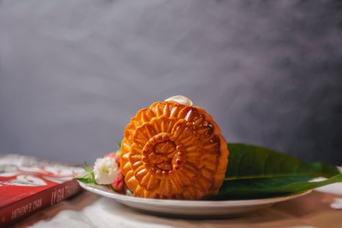 Orange Cookie With Flowers on White Ceramic Plate