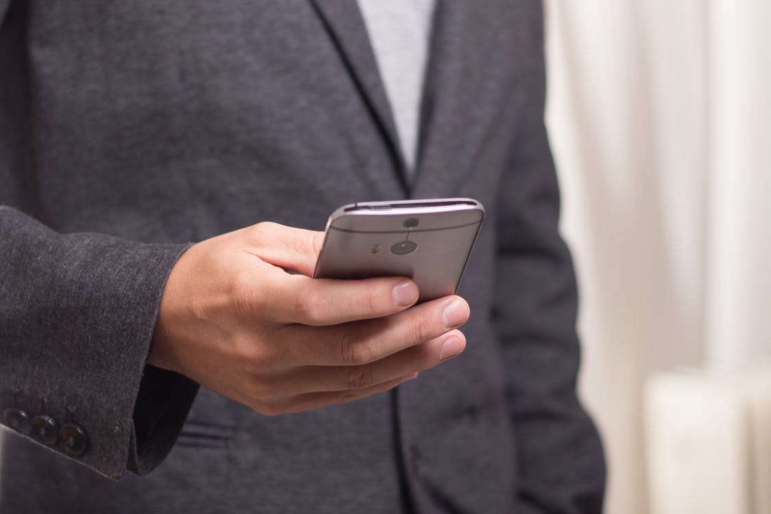 Person Holding Grey Smartphone