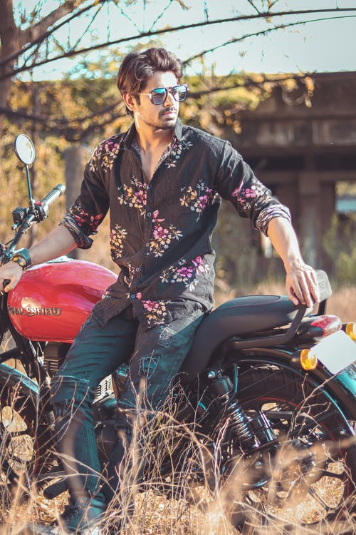 Photo Of Man Sitting On Motorbike