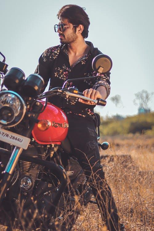 Photo Of Man Riding Motorbike