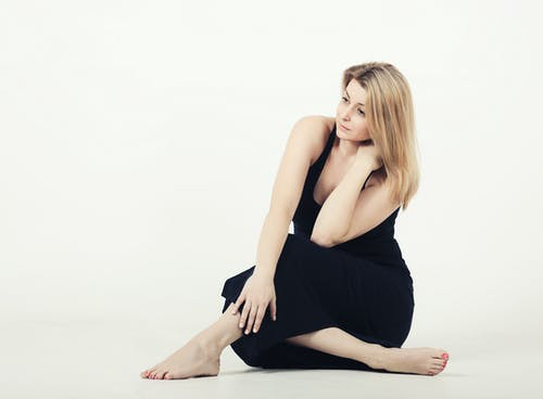 Photo Of Woman Sitting On The Floor