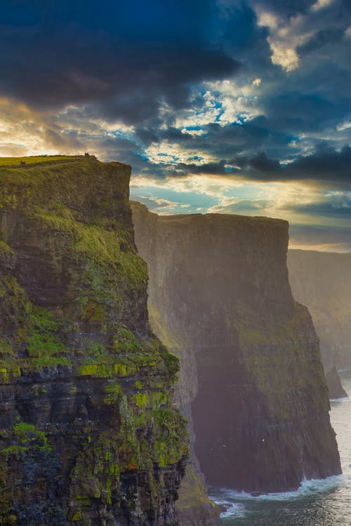 Photo Of Cliff Side During Dawn