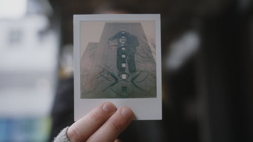 Person Holding a Polaroid Picture