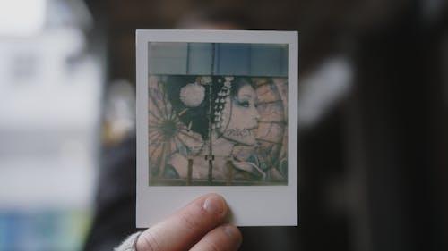 Person Holding White Polaroid Photo