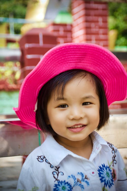 Girl in White Shirt Wearing Red Hat
