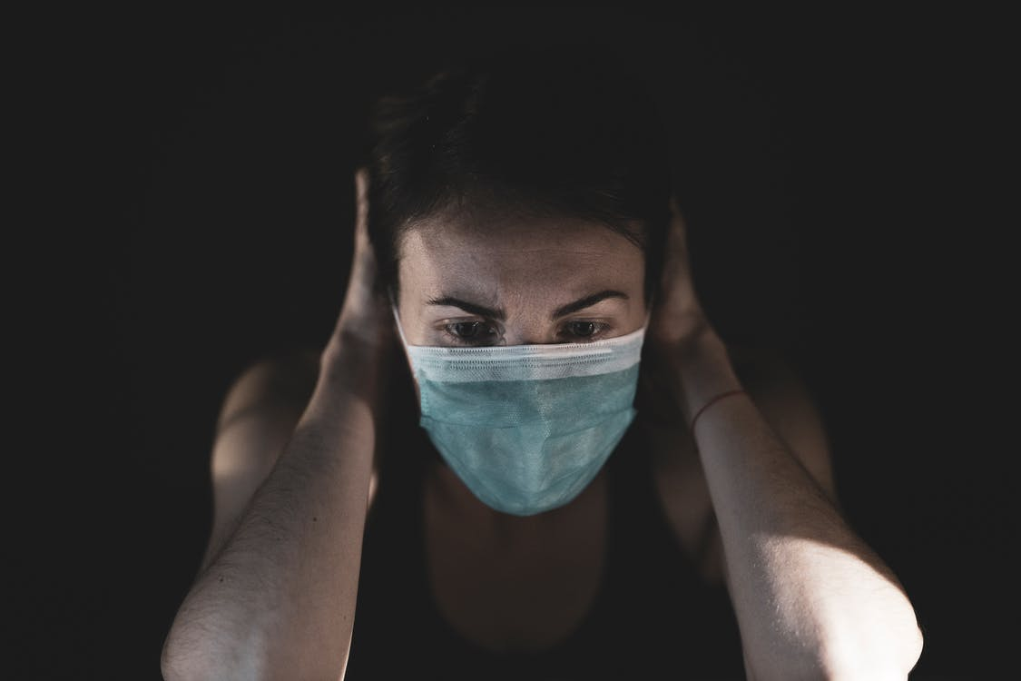 Woman Covering Her Face With Surgical Mask
