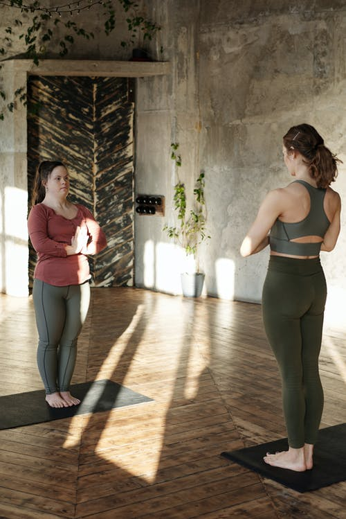 Two Women Doing Yoga Pose