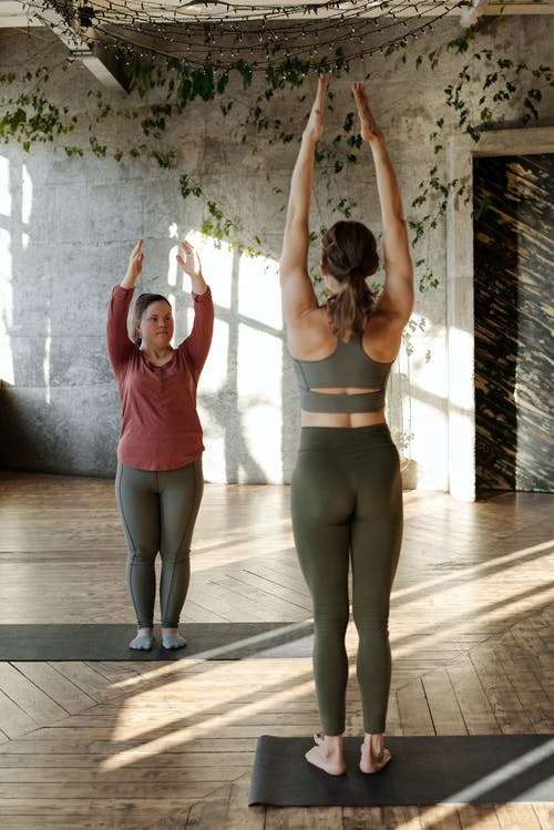 Women Doing Arm Stretch Exercises
