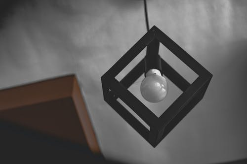 Hanging White Light Bulb on Black Frame