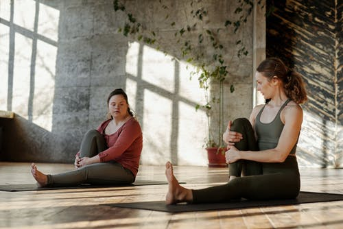 Photo Of Women Doing Yoga Together