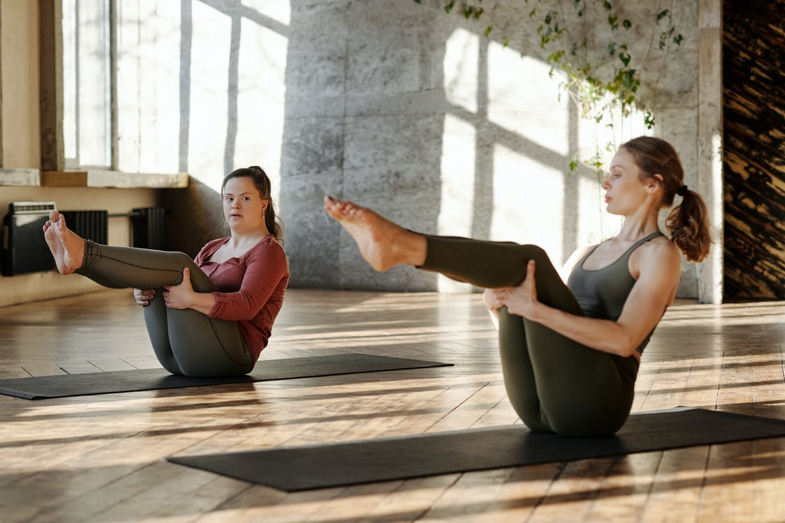 Photo Of Women Exercising Together