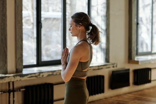 Photo Of Woman Meditating Alone