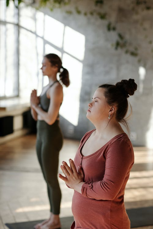 Photo Of Women Meditating Together