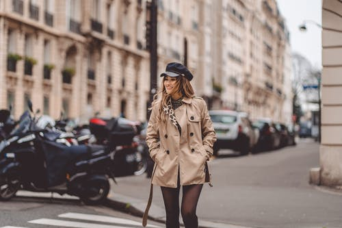 Photo Of Woman Crossing The Street Wearing A Brown Coat