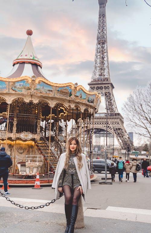 Photo Of Woman Posing Near A Carousel