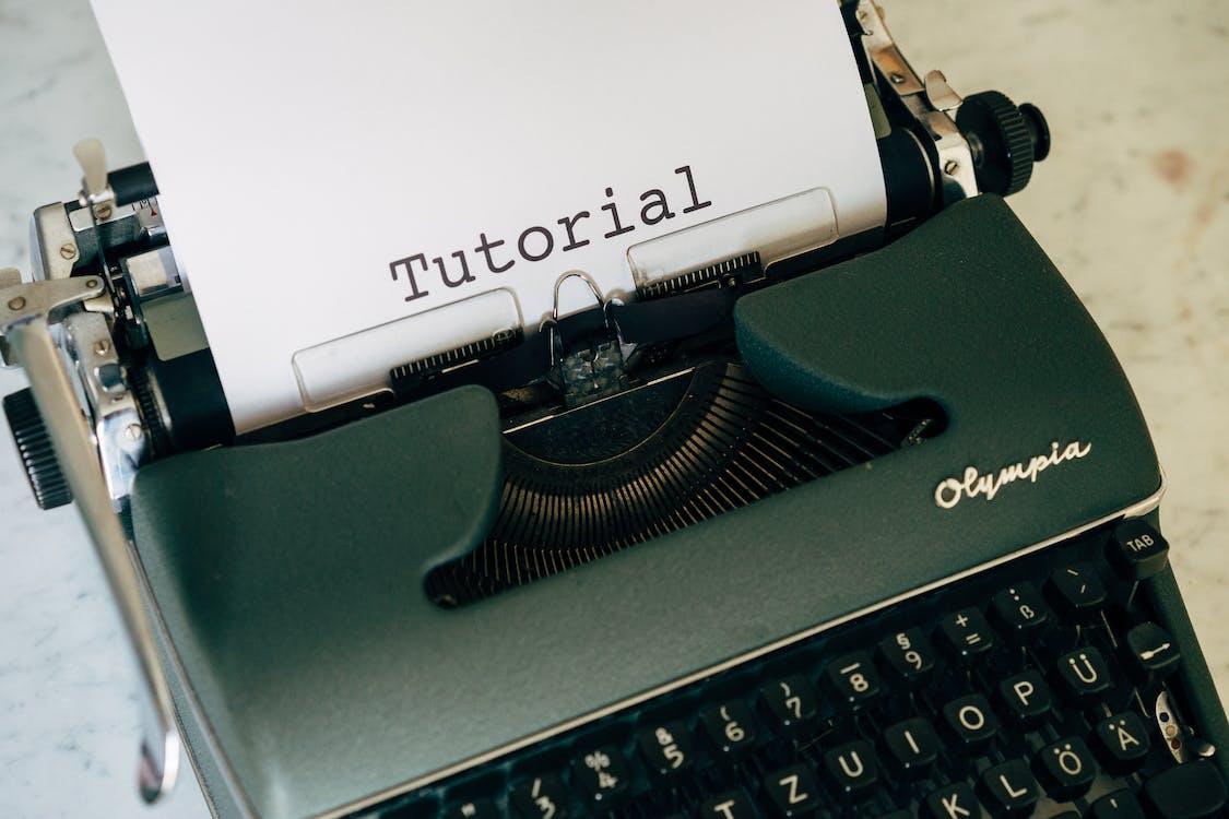 Green Typewriter on White Table