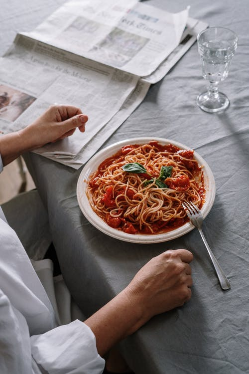 Person Having A Plate Of Spaghetti For Meal