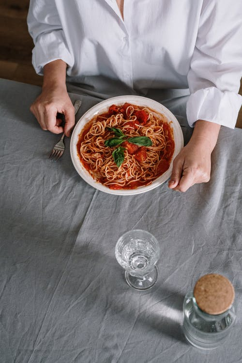 A Plate Of Spaghetti On Table