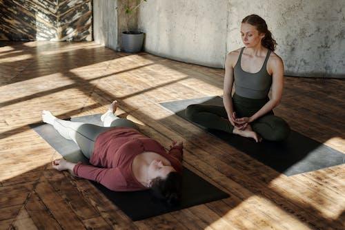 Photo Of Two Women Doing Yoga