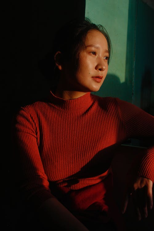 Woman in Red Turtleneck Sweater