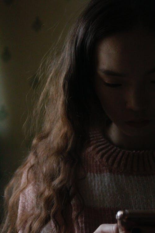 Woman in Brown Knit Turtleneck Sweater