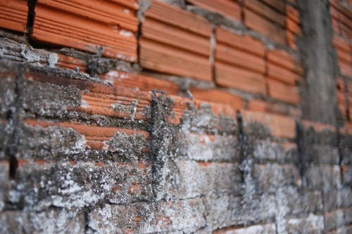Old orange shabby brick wall