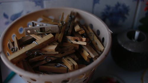 Wooden Clothespins in Plastic Basket