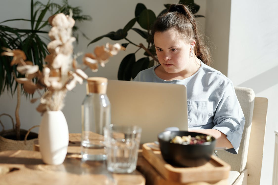 Young Girl Using Laptop Inside A Restaurant