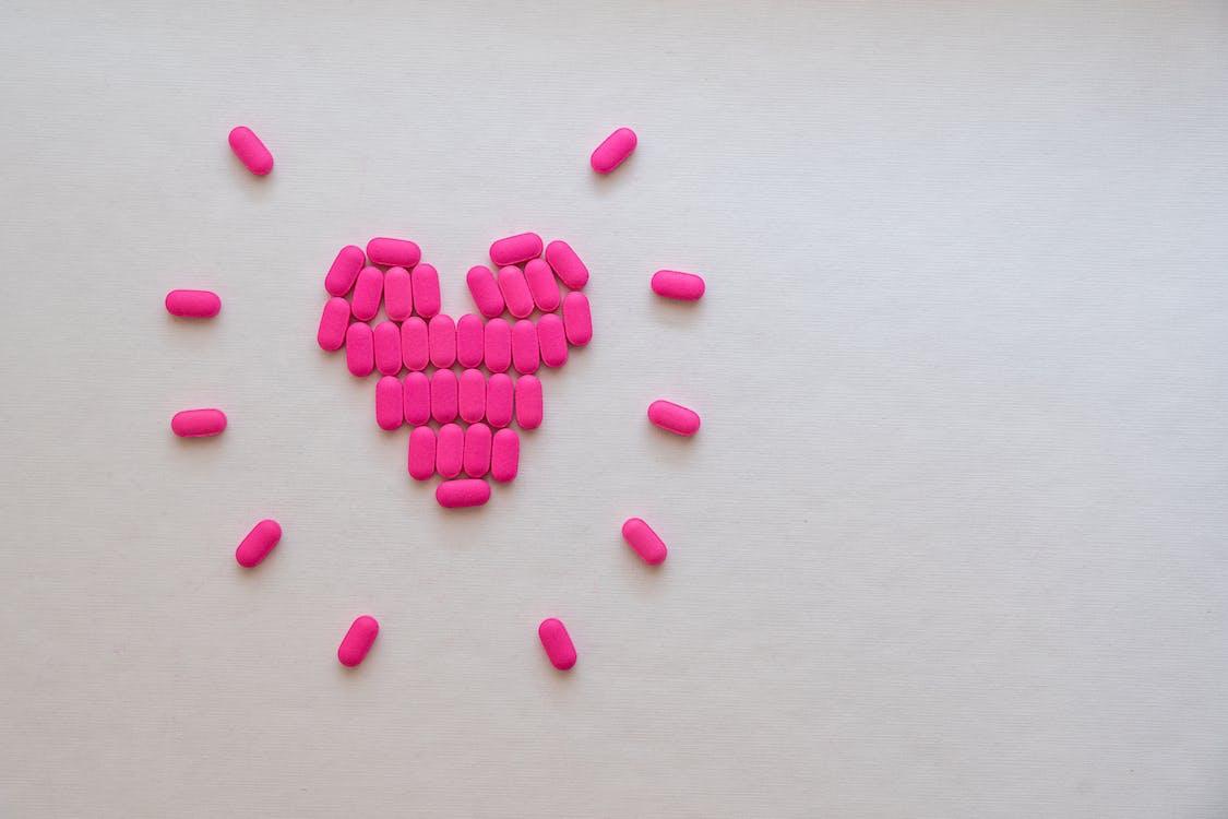Pink Medicines In Heart Shape