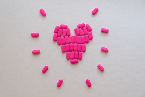 Pink Heart Shaped Medicines on White Surface