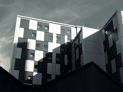 White and Black Building Under Cloudy Sky