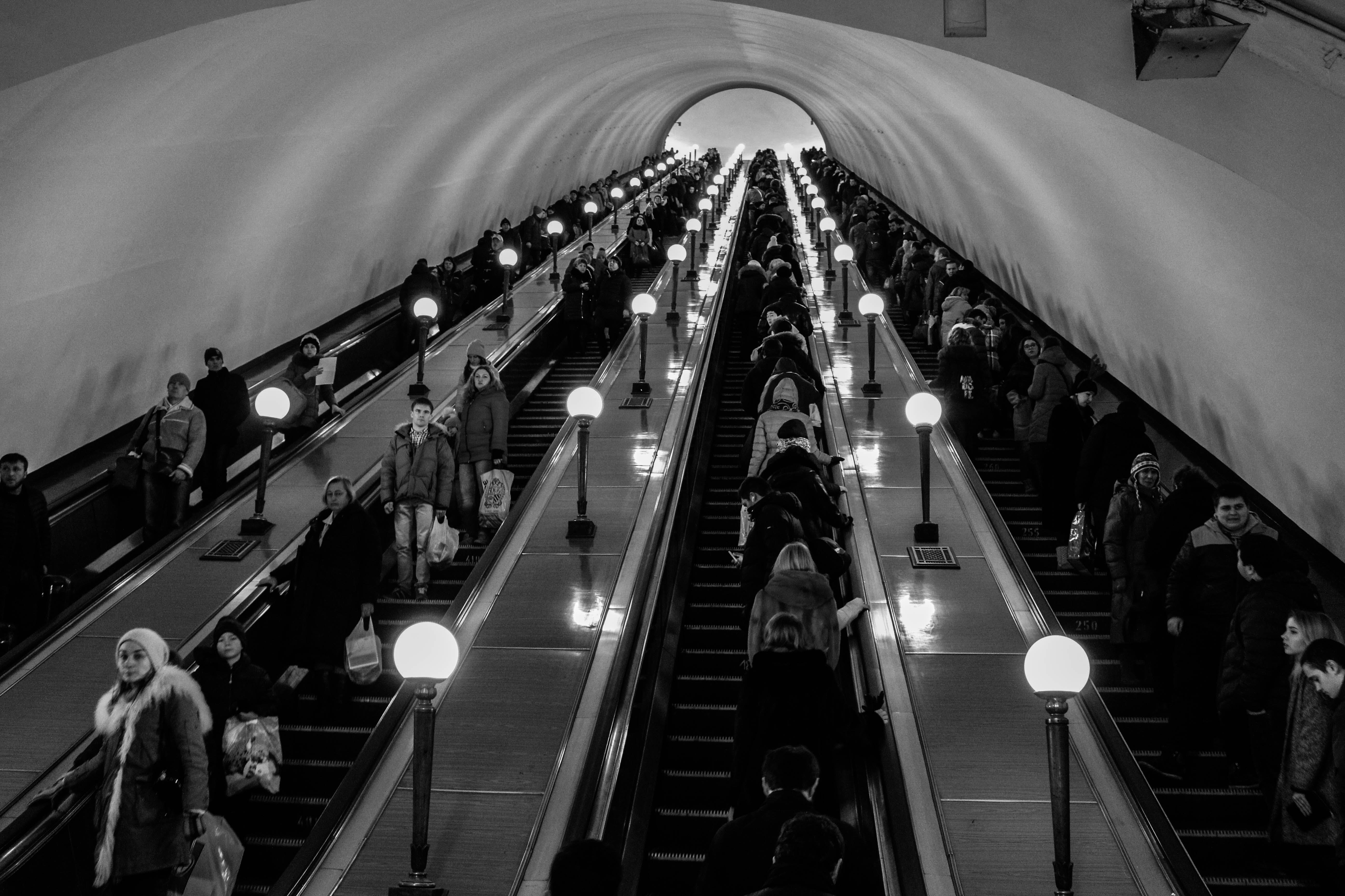 Grayscale Photo of Escalator