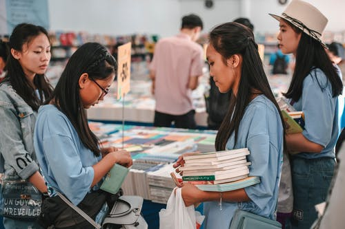 Girls Buying Books