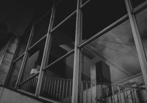 Free stock photo of 1 homem, através da janela, escada