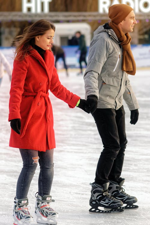 Couple Ice Skating in Rink