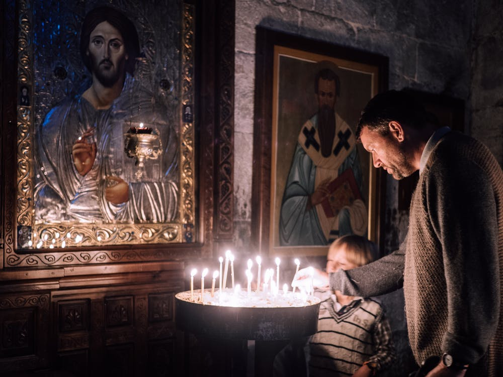 Father and Son Lighting Candles
