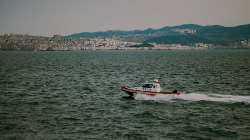 Red and White Boat on Sea