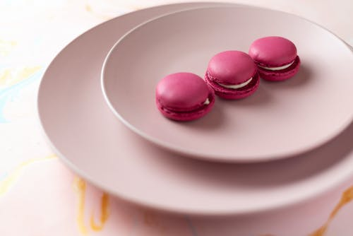 Pink Macarons on White Ceramic Plate