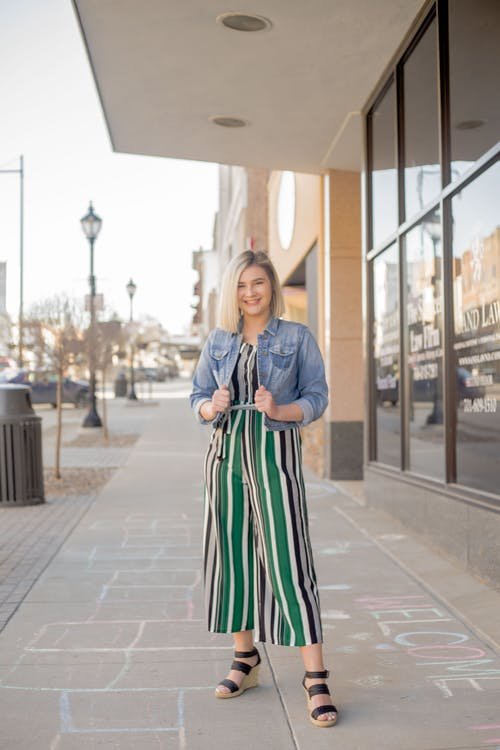 Woman in Blue Green and White Striped Dress Standing on Sidewalk