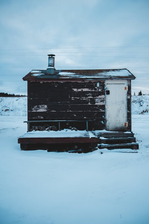 White and Brown Wooden House Covered With Snow