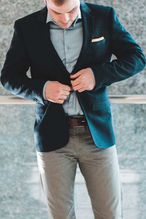 Man in Blue Blazer and Gray Pants