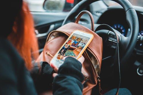 Crop woman surfing social media in car