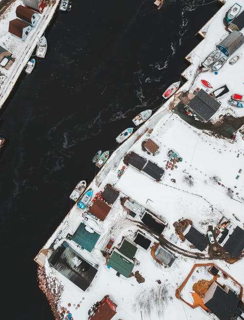 Boats at waterfront of snowy town