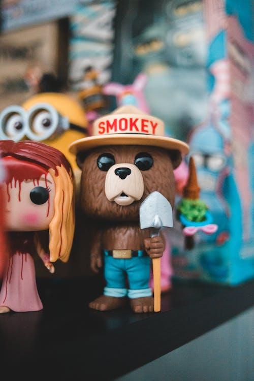 Mascot toy of bear on shelf