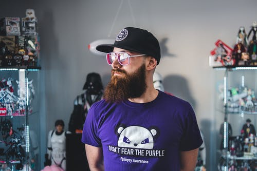 Hipster man with collection of comic character